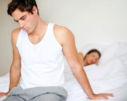 Unhappy young couple in the bedroom